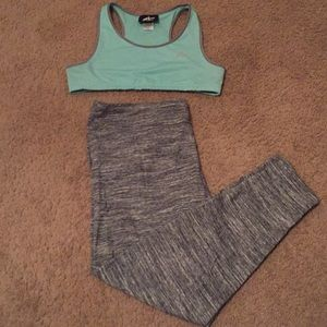A sports bra with striped exercising leggings.